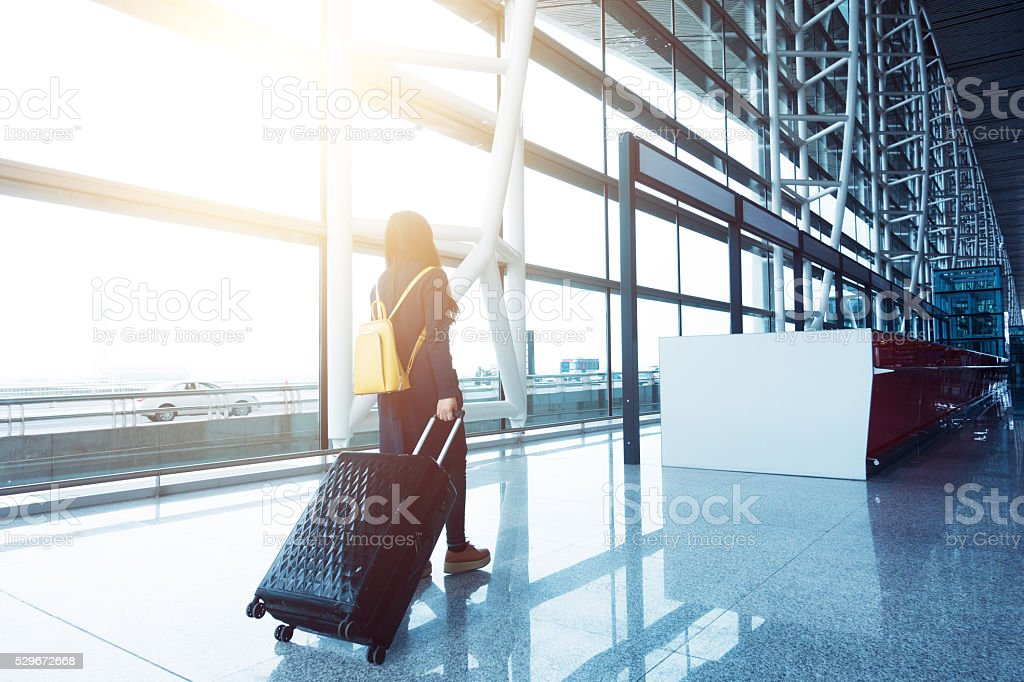 traveler in airport stock photo