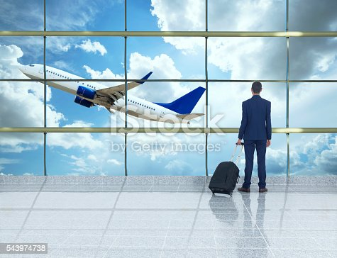 509630674 istock photo traveler in airport 543974738