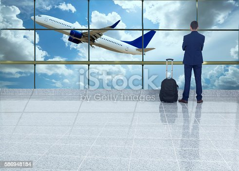 509630674 istock photo traveler in airport 586948184