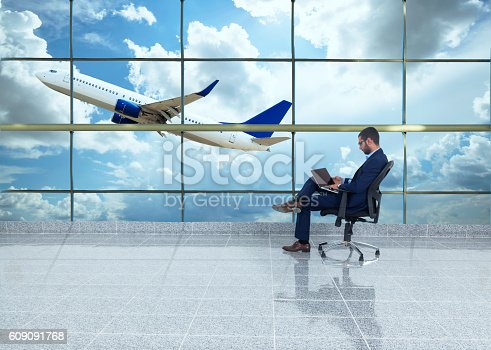509630674 istock photo traveler in airport 609091768