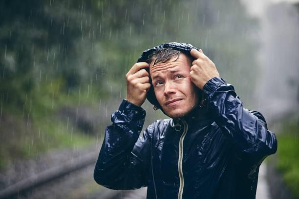Traveler in heavy rain stock photo