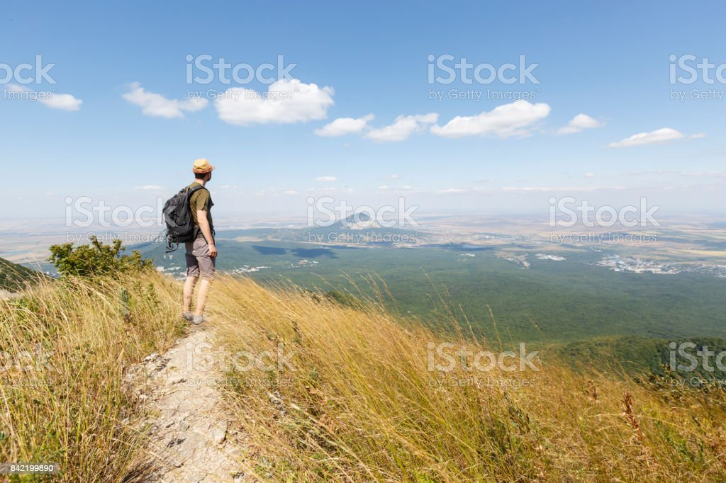 A traveler is hiking in Pyatigorsk in Stavropol region of Russia on the Beshtau mountain stock photo