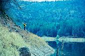istock Traveler Looks at Landscape 1073229378