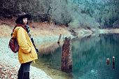 istock Traveler Looks at Landscape 1073229550