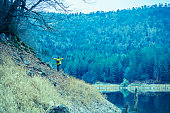 istock Traveler Looks at Landscape 1073229798