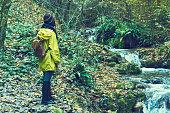 istock Traveler Looks at Landscape 1073230336