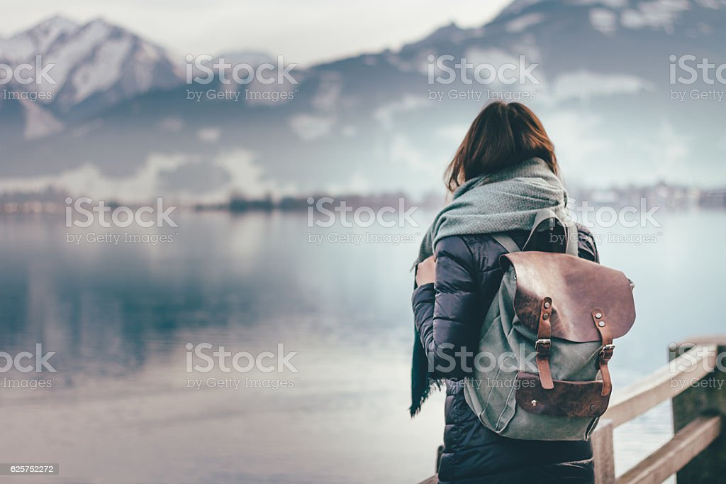 Traveler looks at landscape stock photo