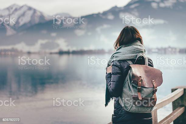 Photo of Traveler looks at landscape