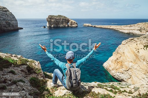 Traveler Man Feels Free Seeting On The Rocky Seaside Of Blue Lagoon Stock Photo & More Pictures of Adult