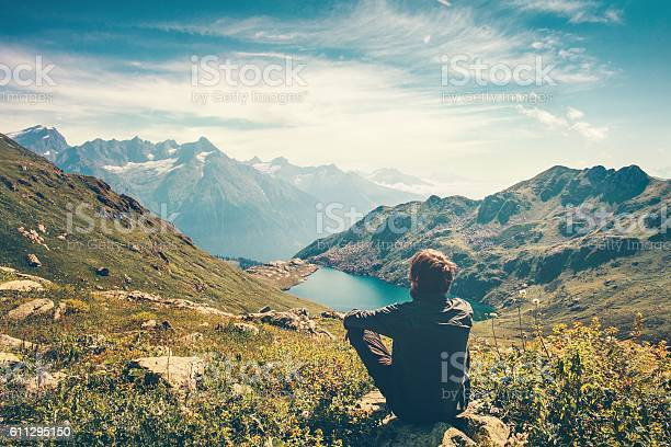 Photo of Traveler Man relaxing Travel Lifestyle mountains and lake landscape