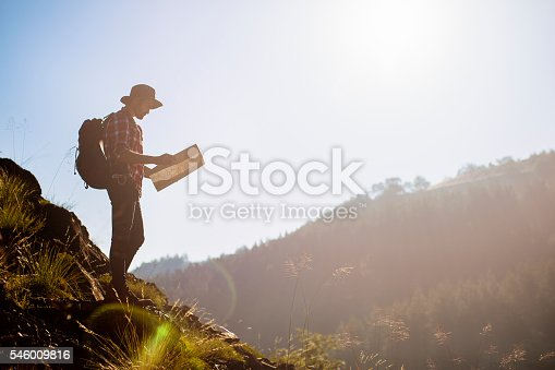 istock Traveler man with backpack and map on hiking 546009816