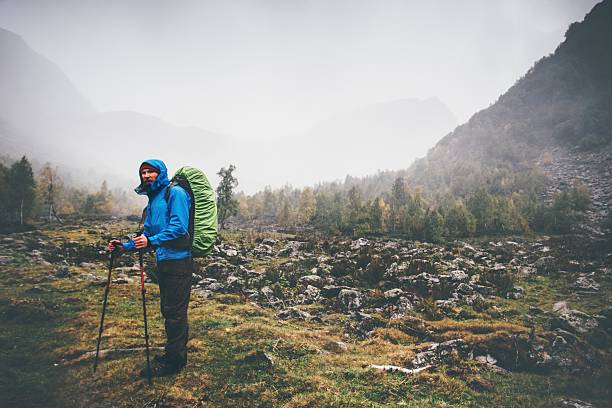 Traveler Man with backpack hiking Travel Lifestyle concept – Foto