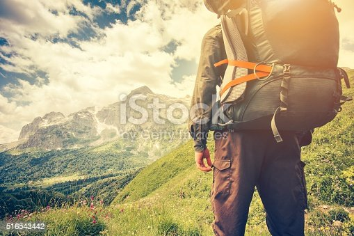 istock Traveler Man with backpack mountaineering Travel Lifestyle concept 516543442