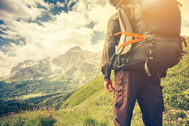 Traveler Man with backpack mountaineering Travel Lifestyle concept stock photo
