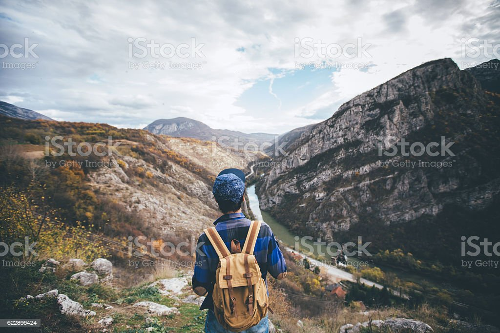 Traveler Man with backpack stock photo