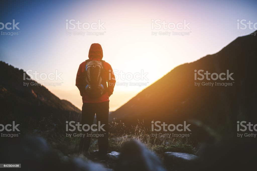 Traveler meets the sunrise in the mountains stock photo
