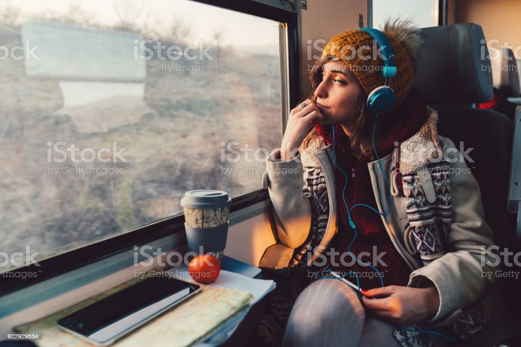 Traveler on a journey with train stock photo