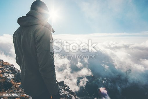 istock Traveler on mountain summit with sun over clouds Travel Lifestyle success concept adventure active vacations outdoor 1032758576