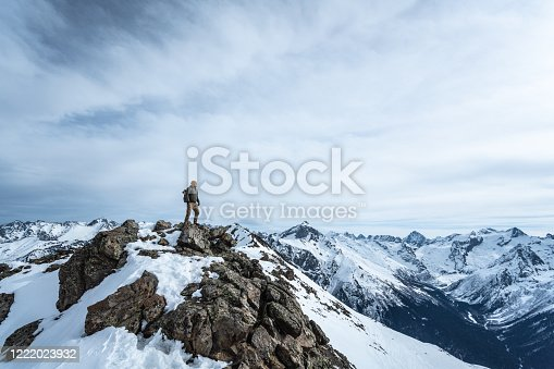 Traveler on the top of a mountain
