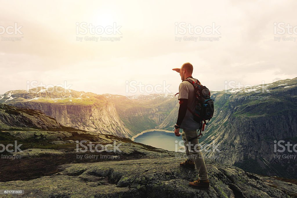 Traveler on the top of a mountain plateau stock photo