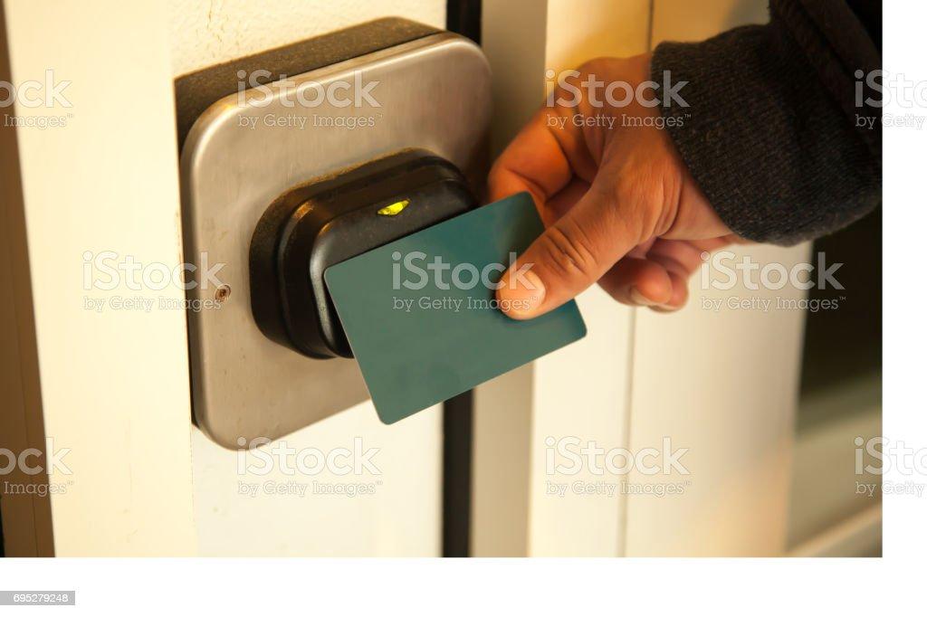 Traveler opening hotel room door by plastic keycard stock photo
