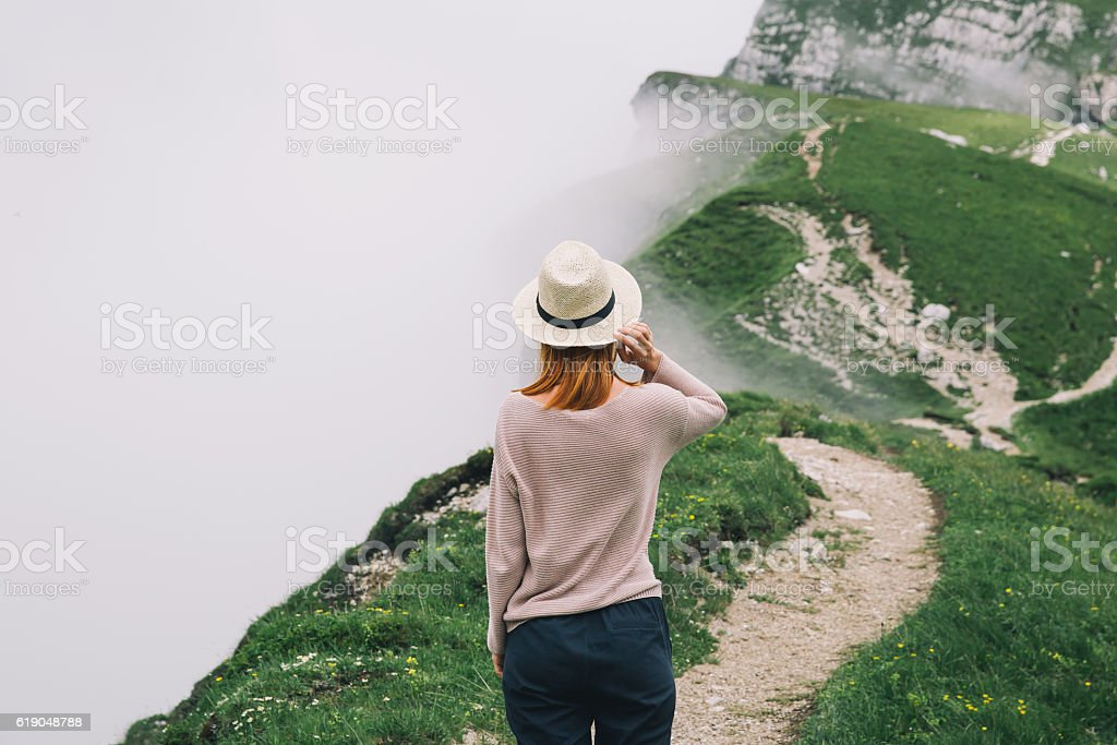 Traveler or hiker in the mountains stock photo