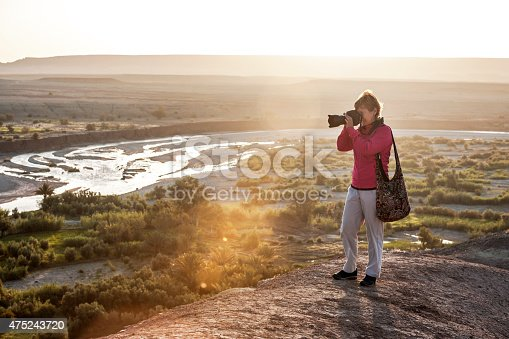 872393896istockphoto Traveler photographing morning Aït Ben Haddou,  Morocco, North Africa 475243720