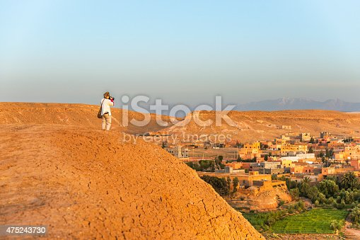 872393896istockphoto Traveler photographing morning Aït Ben Haddou,  Morocco, North Africa 475243730