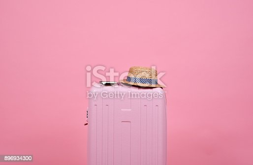 istock Traveler pink suitcase and passport document over pink background, Journey and travel concept. 896934300