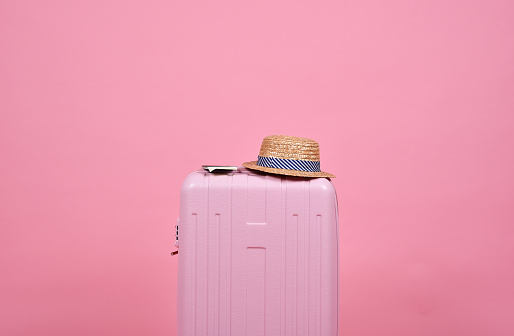 Traveler Pink Suitcase And Passport Document Over Pink Background Journey And Travel Concept Stock Photo - Download Image Now