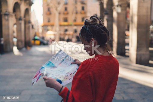 Young woman using map in Spain