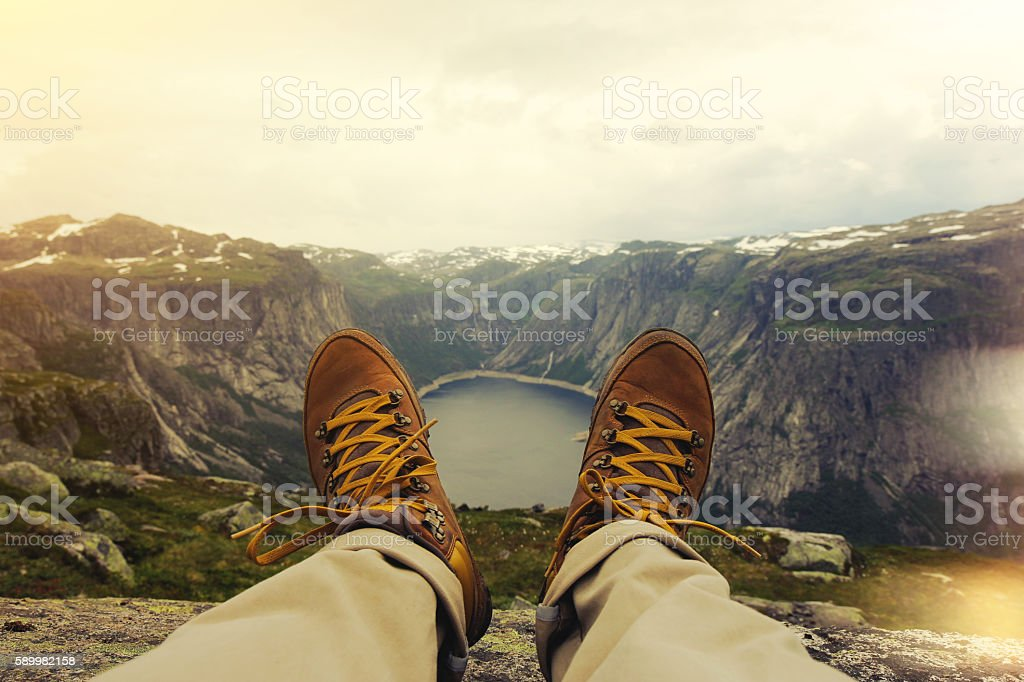 Traveler resting on a mountain plateau stock photo