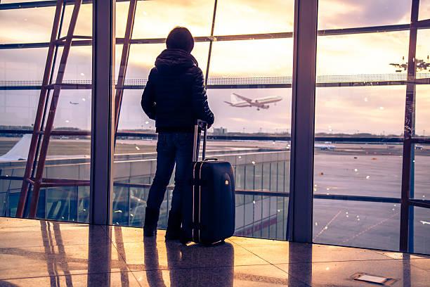 Traveler silhouettes at airport,Beijing stock photo