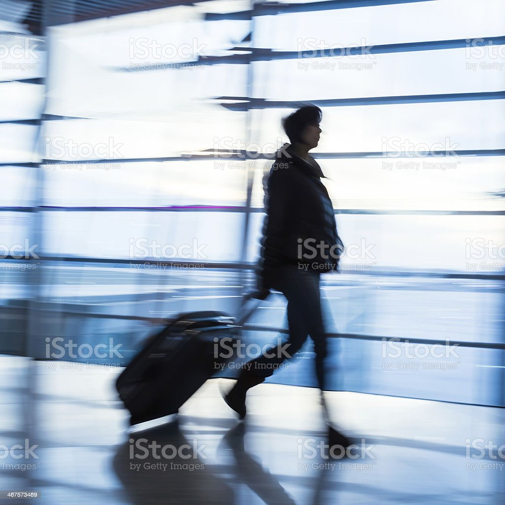Traveler silhouettes at airport,motion blur,Beijing royalty-free stock photo