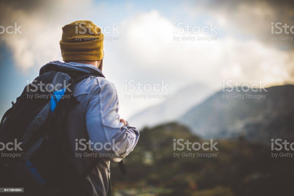 Traveler solitude in mountains stock photo