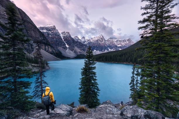 Traveler standing on Moraine lake with Canadian rockies in Banff national park stock photo