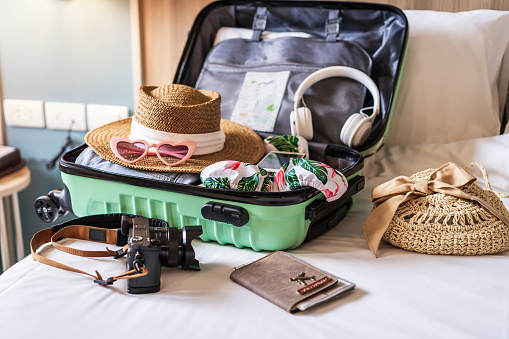 Traveler suitcase and luggage with travel accessories and items preparing for travel