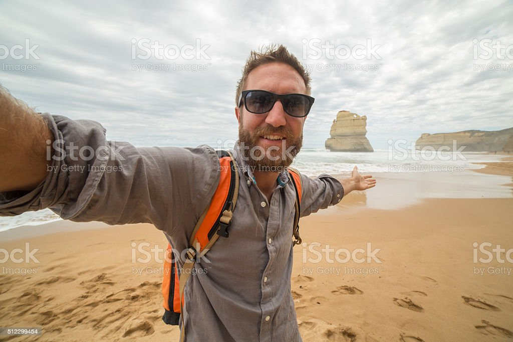 Traveler takes selfie portrait on Gibsons steps beach-Great ocean road stock photo