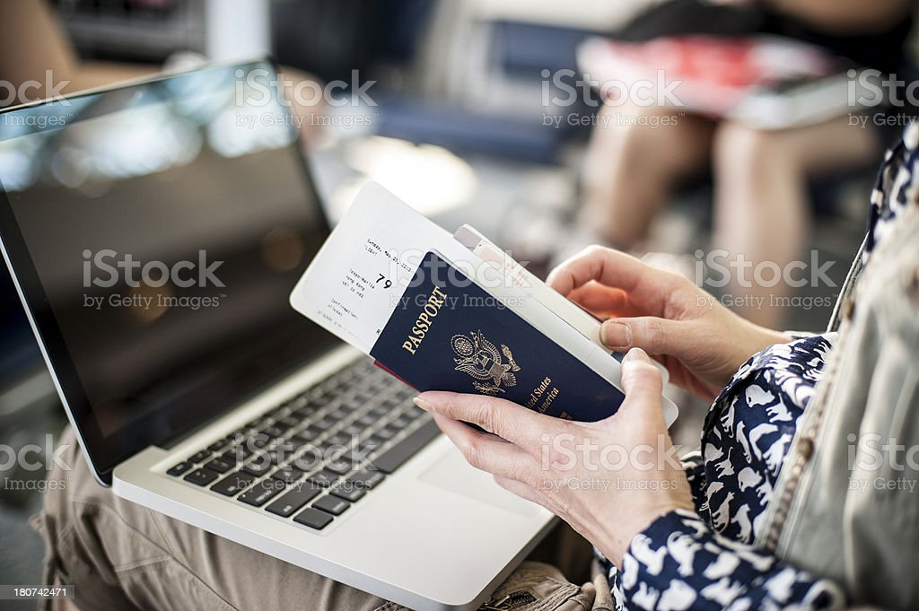 Traveler using computer at the airport stock photo