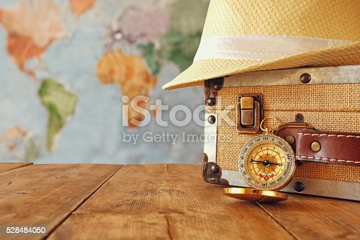 istock traveler vintage luggage, compass and fedora hat 528484050