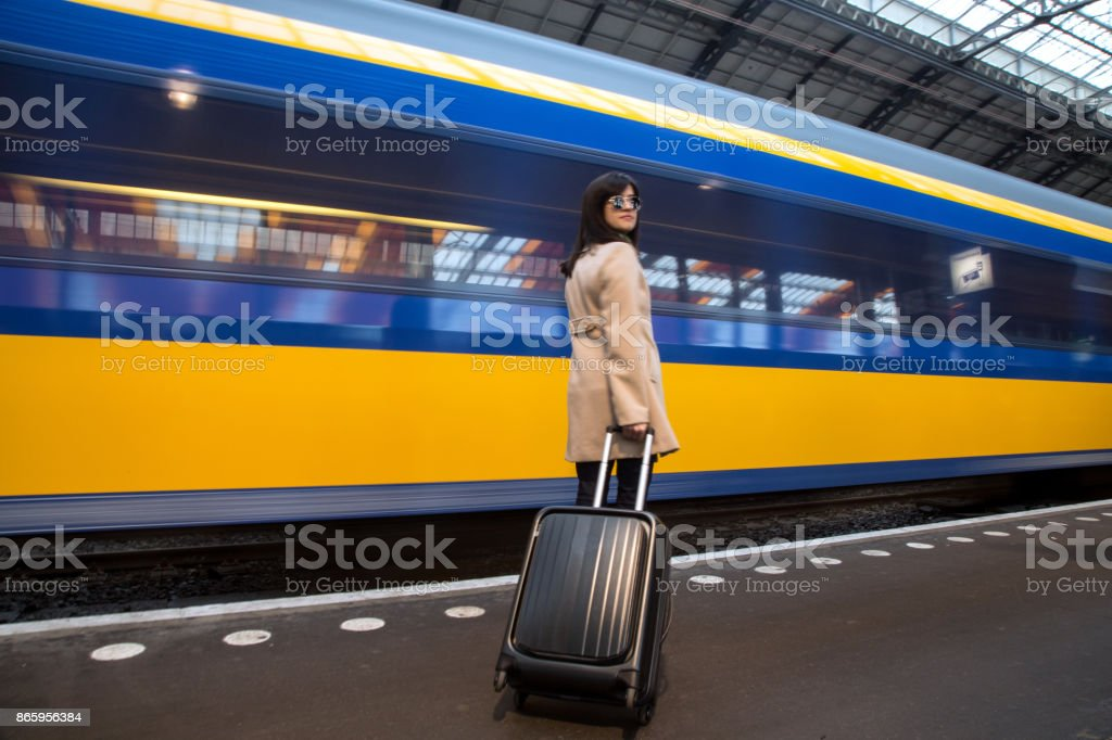 Traveler waiting the train with sunglasses stock photo