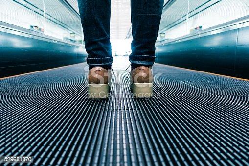 istock Traveler walking in airport 529681870