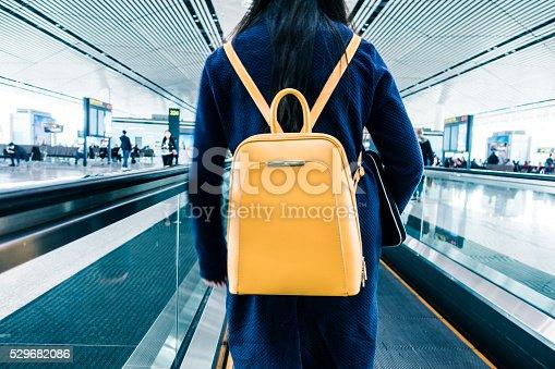 istock Traveler walking in airport 529682086