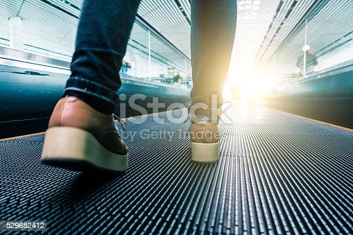 istock Traveler walking in airport 529682412
