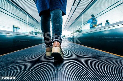 istock Traveler walking in airport 529682848