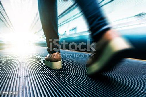 istock Traveler walking in airport 529682992