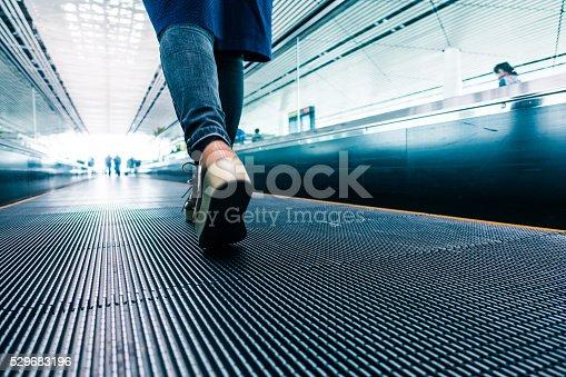 istock Traveler walking in airport 529683196