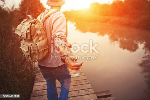 istock traveler walking over wooden bridge in sunset 538404865