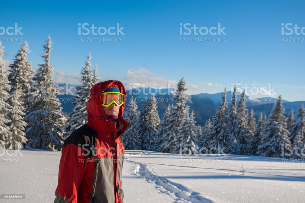 Traveler wearing a jacket with a hood in winter stock photo