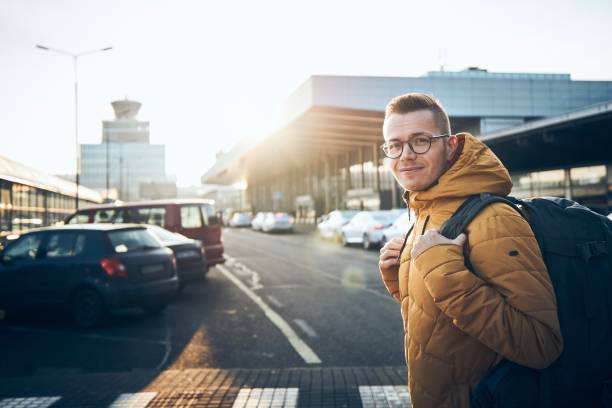 Traveler with backpack at airport stock photo